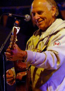 Jimmy Buffet playing guitar