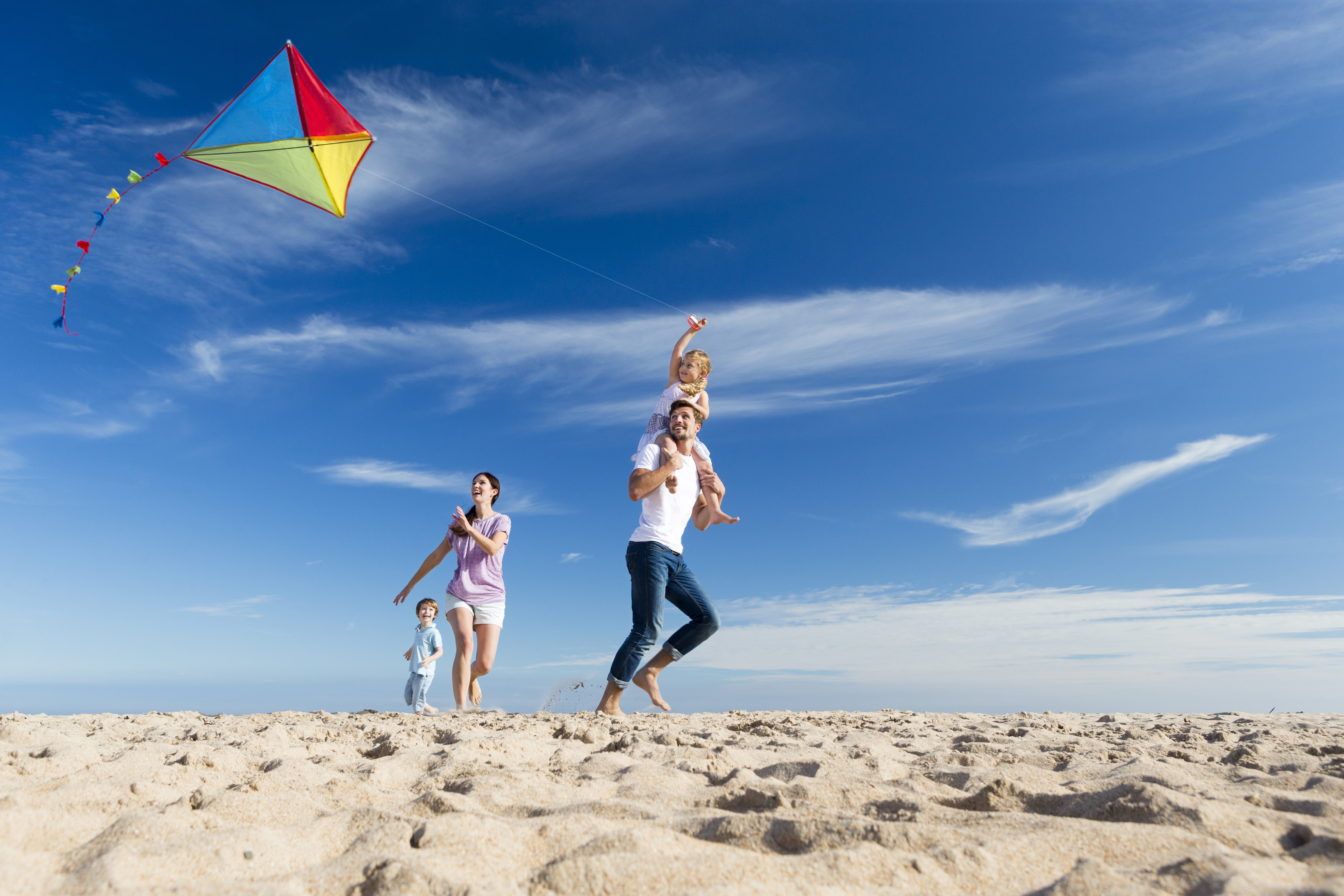 Family on the Beach Flting a Kite