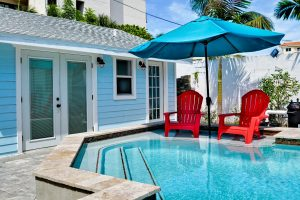 Florida Beach Rentals Seaside Cottage mother daughter chair umbrella pool 2