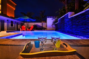 Florida Beach Rentals Seaside Cottage illuminated pool fiesta